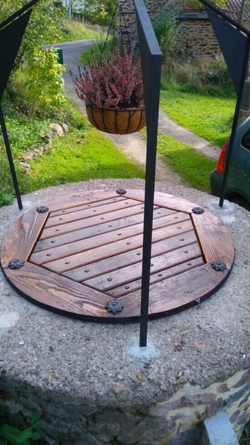 Décoration par notre client d'une grille de puit réalisation à partir de notre gamme de pièces détachées. Localisation Lot
